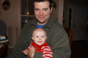 Daddy and baby at Christmas dinner