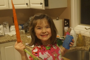 Cleaning the carrots for the reindeer (can you tell she's a little excited?)